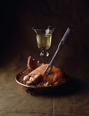 pork with lentils and glass of white wine