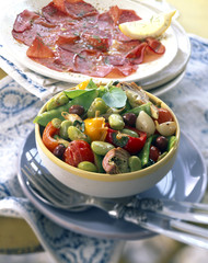 Plate of Bresaola mixed vegetables fried Italian-style