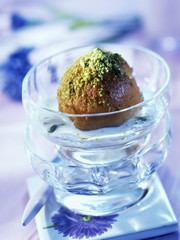 Pan-fried peach with pistachios