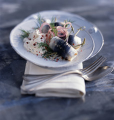 Rollmops with cream,dill and pink peppercorns