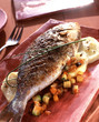Grilled sea bream with spices on potatoes