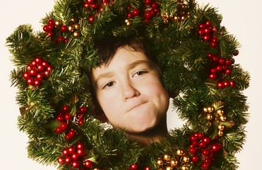 Young Boy In Christmas Wreath