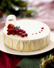 Coconut and summer fruit iced cake