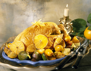 Roast capon with citrus fruit and figs