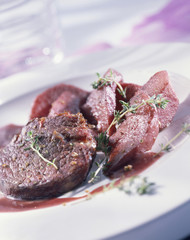 Venison fillet steak with pears cooked in red wine