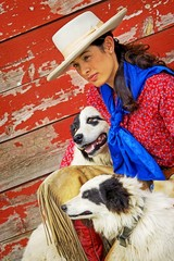 Cowgirl With Two Dogs
