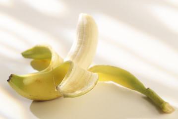 half-peeled banana