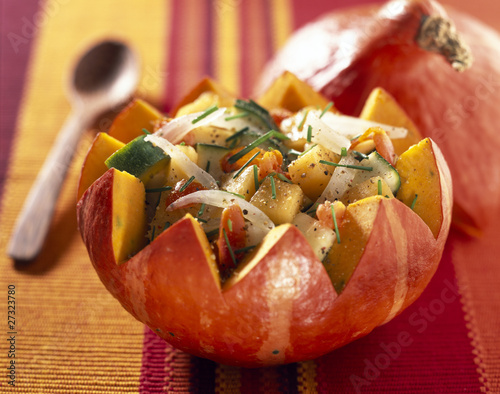 Pumpkin salad served in half a pumpkin