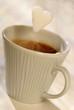 sugar lump falling into cup of coffee