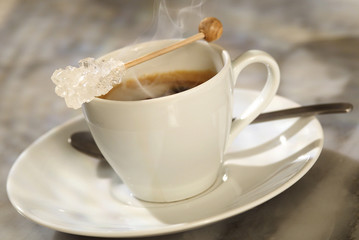 sugar stick placed on coffee cup