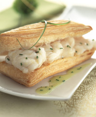 Puff pastry case filled with monkfish and asparagus sauce