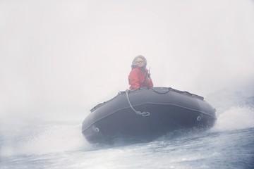 Woman Riding A Raft