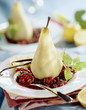 steamed vanilla pear on bed of stewed summer fruit