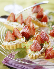 pastry boat filled with strawberries,whipped cream and pistchios