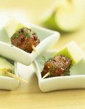 Mini brochettes of marinated fish