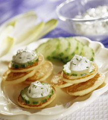 Blinis with cucumber and cream