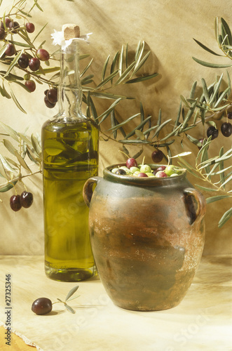 Bottle of olive oil and jar of olives