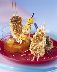 chicken breast skewers with sesame seeds and mango chutney