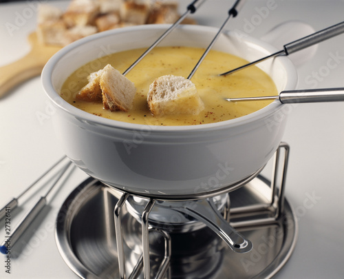 Diping the bread into the Fondue