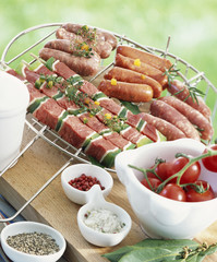Selection of raw brochettes and mini sausages