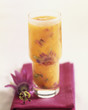 Orange juice with passionfruit flowers