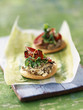 Mini pizzas with fresh goat cheese,tapenade and mayonnaise