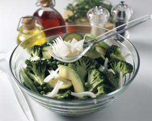 Adding the spring oignons to the salad