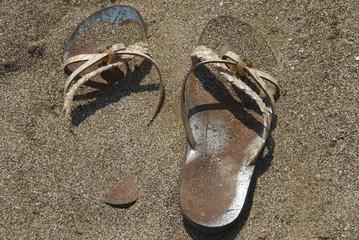Sandals over a beach