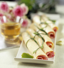 Rolled pancakes with rose petals and chives