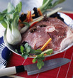 Raw thick round salt pork fillet with vegetables