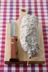 Dried sausage on chopping board
