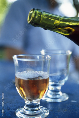 serving a glass of white wine