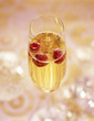 Glass of champagne with raspberries