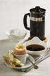 Soft-boiled egg with soldiers and coffee