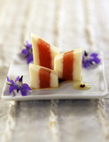 Squares of kakis and almond milk jelly