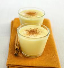 Glasses of custard with cinnamon