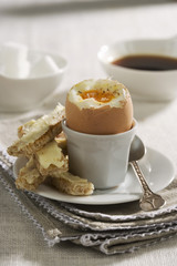 Soft-boiled egg with soldiers