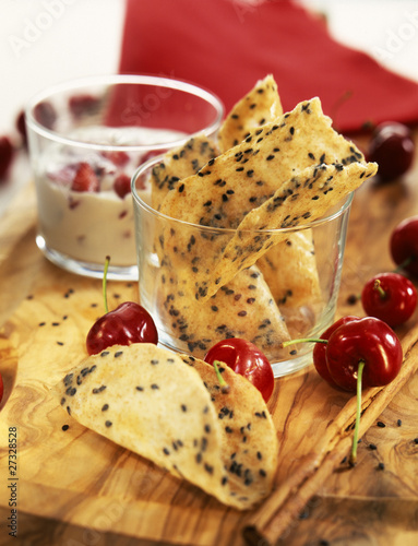 Crunchy and spicy tuile biscuits with fromage frais