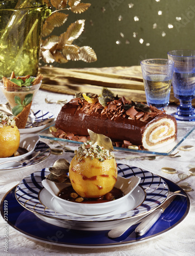 Caramelized peach with crushed pistachios and hazelnuts,chocolate and peach log cake