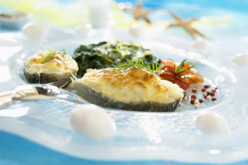 Thick slice of fish au gratin