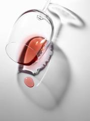 Spilt glass of rosé wine