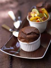 Chocolate soufflé and fruit salad