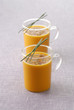 Glass cups of carrot soup