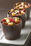 Dark chocolate verrines with crumbled sponge cake,raspberries and pistachios