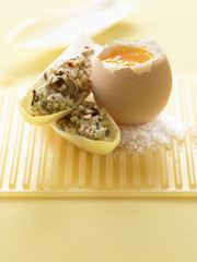 Soft-boiled egg with chicory leaves filled with blue cheese