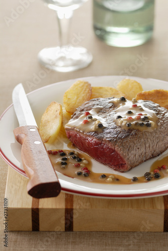 Thick beef steak with pepper sauce