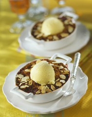 Quetsch plum and finely sliced almond crumble with almond ice cream