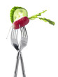 Two forks with radish and cucumber ;light lunch