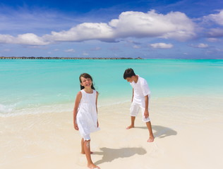 Two children on white sand