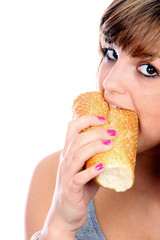 Young Woman Eating French Stick Bread. Model Released